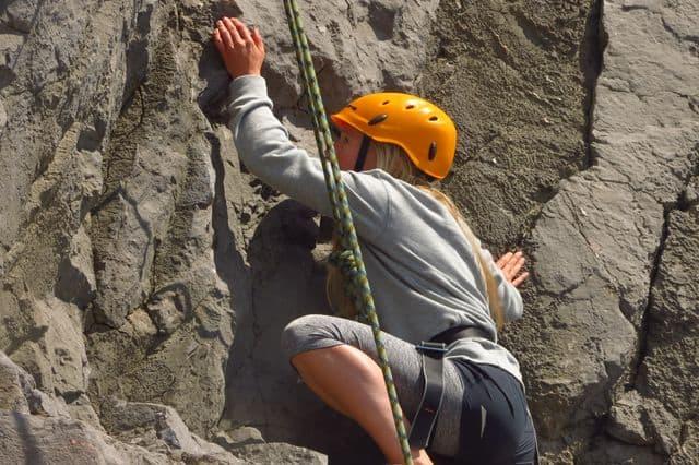 Girl rock-climbing in Brecon Beacons, Wales