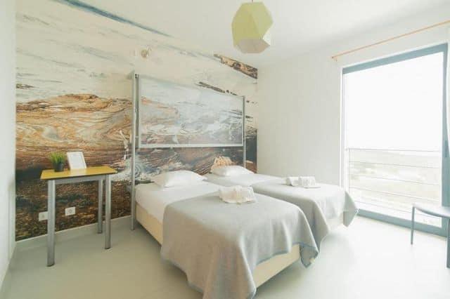 Twin en-suite room in hen-friendly hostel Arrifana, Algarve