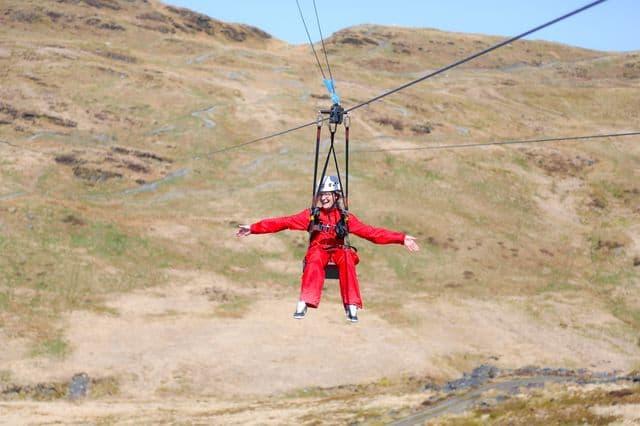 Girl ziplining in ZipWorld North Wales
