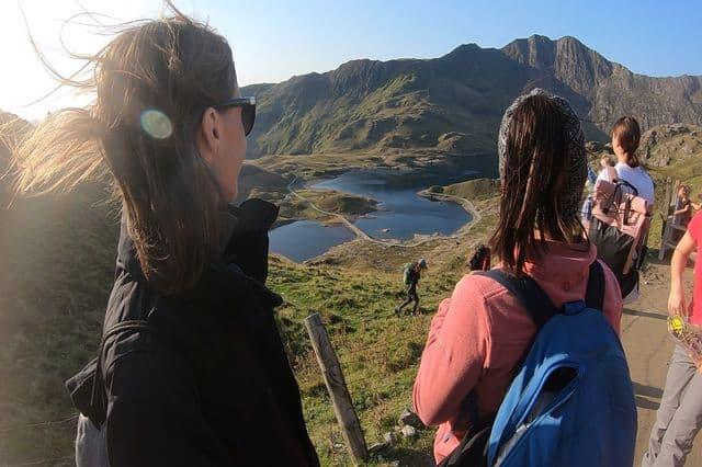 Girls enjoying the mountain view during a hike in Snowdonia