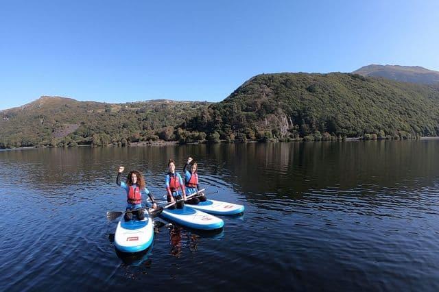 Hen group paddleboarding on Llanberis Lake in Snowdonia