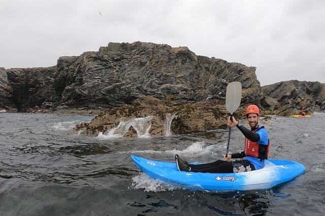 Man enjoying a sea-kayaking activity in Anglesey, North Wales