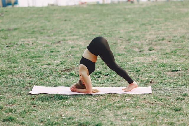 Woman practising yoga on a corporate wellness retreat