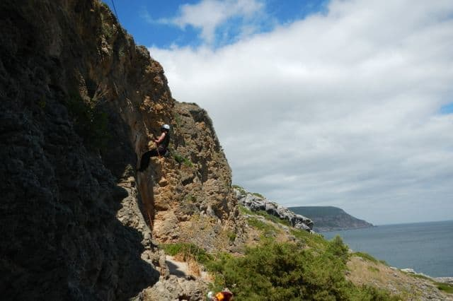 Rock climbing on the Arrabida coastline on a company retreat in Lisbon Portugal