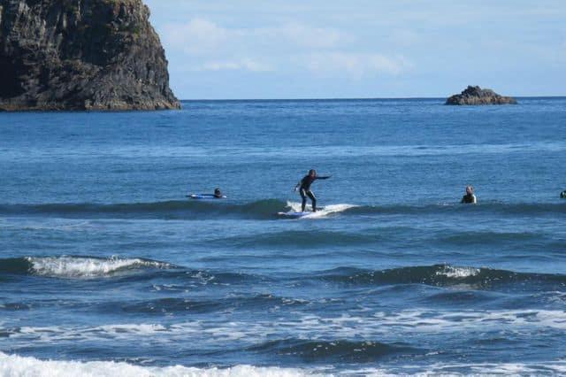 A guy surfing a wave in Porto da Cruz, Madeira
