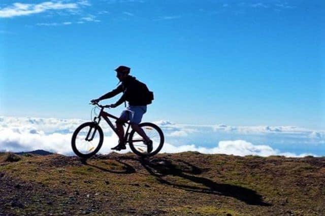 Man mountain-biking on Madeira Island, Portugal
