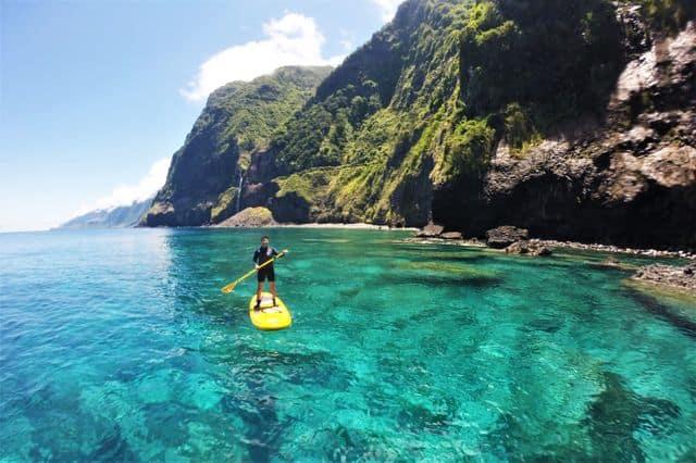 A man paddleboarding along the Madeira coastline