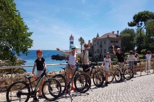 A family enjoying a guided cycling tour around Lisbon & Cascais