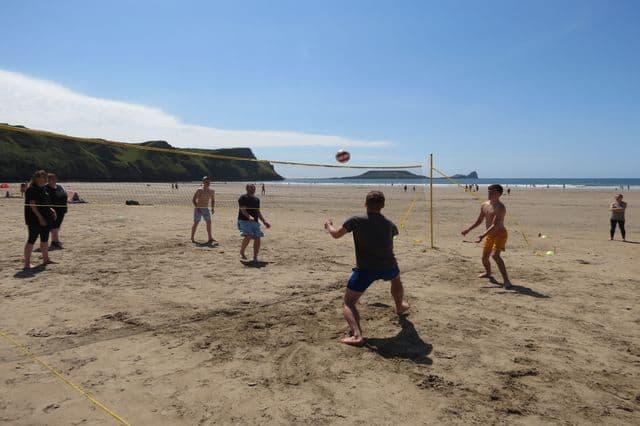 A team beach Olympics challenge in Rhossili Bay