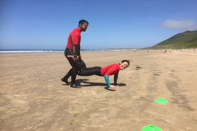 A team building beach Olympics challenge in Rhossili Bay