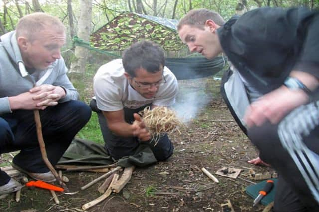 Team building bushcraft activity in Swansea
