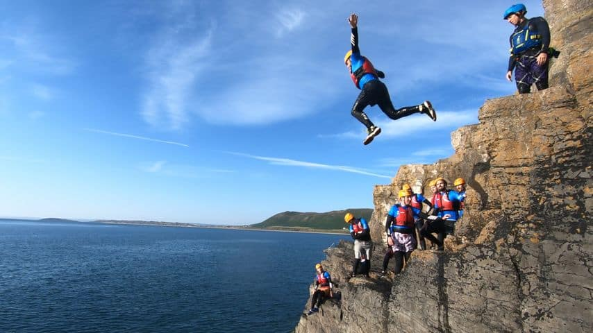 A family enjoying a coasteering activity in Wales